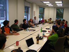 Company meeting cross-departmental employees - flickr tvol - Peter Barron Stark Companies