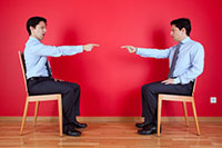 wo business men pointing at each other - cross-departmental communication issues - Peter Barron Stark Companies